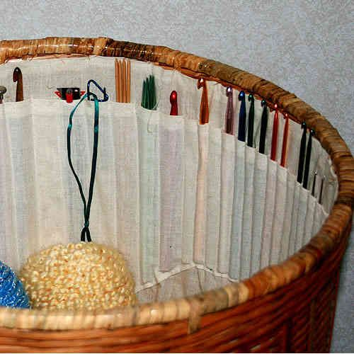 crochet hook basket - You could make this rather easily.  You must fit it to a specific basket.  It would be great for hooks and needles and scissors, etc. and could sort individual WIP or be used generically.