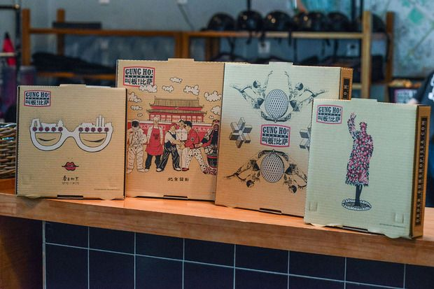 Beijing's eco-friendly Gung Ho! Pizza tops their sustainable pies with organic ingredients and collectable art boxes