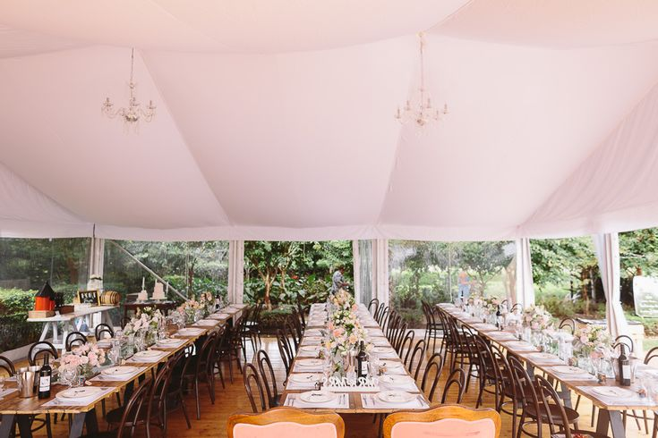 silk lining, chandeliers, 10m marquee structure, integrated timber flooring, vintage timber tables, bentwood chairs, south coast weddings, south coast party hire