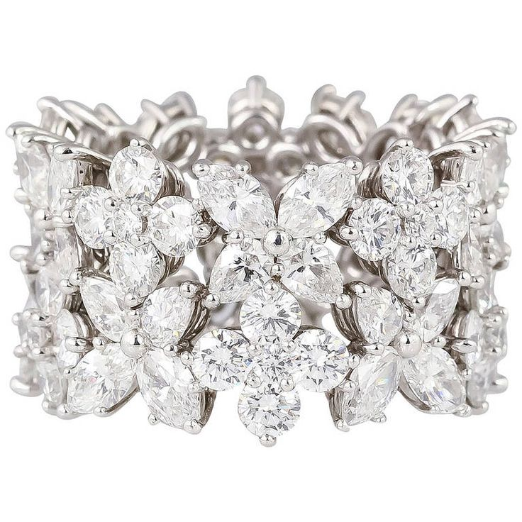 Harry Winston Diamond Platinum Wide Band | From a unique collection of vintage band rings at https://www.1stdibs.com/jewelry/rings/band-rings/