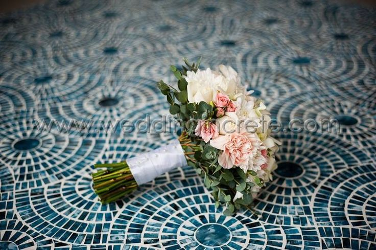 Bridal bouquet lying on a beautiful table in Grecotel White Palace, Rethymno delivered & created by MOMENTS weddings & events