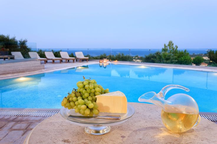 Spent a #relaxing #night by the #pool with a glass of #wine! #PaliokalivaVillage #Zante