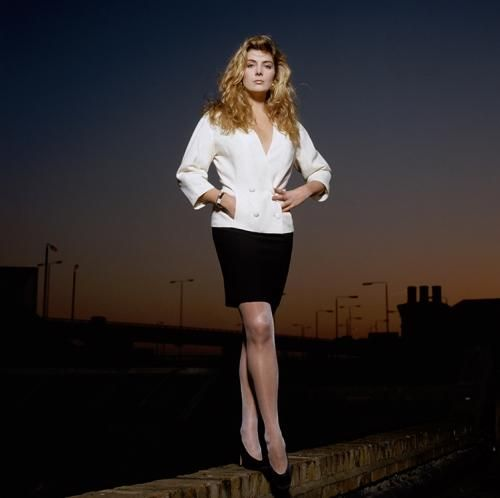 """Natasha Richardson On A Wall  By Terry O'Neill   British actress Natasha Richardson standing on a wall in a suburban setting, early 1990s.  Limited Edition C-Print Signed and Numbered  16"""" x 16"""" / 20"""" x 20""""  24"""" x 24"""" / 30"""" x 30""""  40"""" x 40"""" / 48"""" x 48"""" / 60"""" x 60"""" / 72"""" x 72""""  For questions or prices please contact us at info@igifa.com     IGI FINE ART"""
