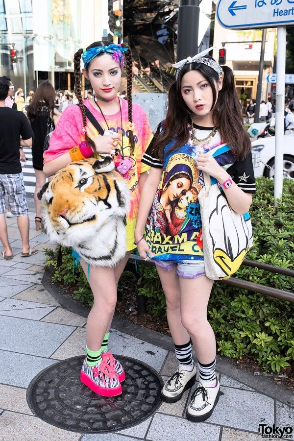 [Sisters in Harajuku w/ Twintails, Tie-dye, Tiger Head & Donald Duck] Left: Mizuho is wearing a bright tie-dye shirt from WEGO with blue WEGO cutoff shorts and neon pink zebra print Kokopelli creepers. , Right: Yirika, is wearing a space-meets-Renaissance print top from Sevens with purple Jouetie cutoffs, striped socks, and white creepers. #CuteSisters #HarajukuFashion
