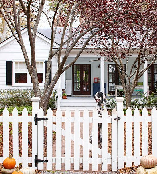 Simple and Stylish White Picket Fencing - Surround your home with classic charm and install a white picket fence complete with a swinging gate and seasonal decor. This welcoming sight is sure to cheer up your yard and reflect a timeless, sophisticated style.