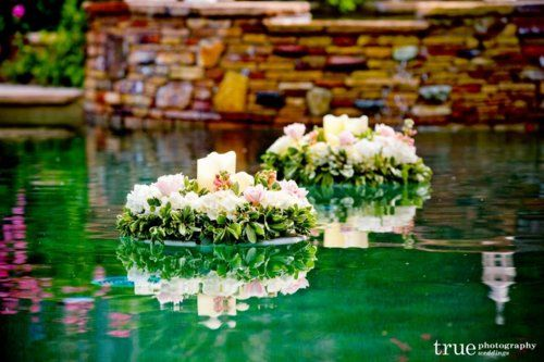 Floating flowers in pool swimming pool decorations pinterest florists floral design and for Floating candles swimming pool wedding