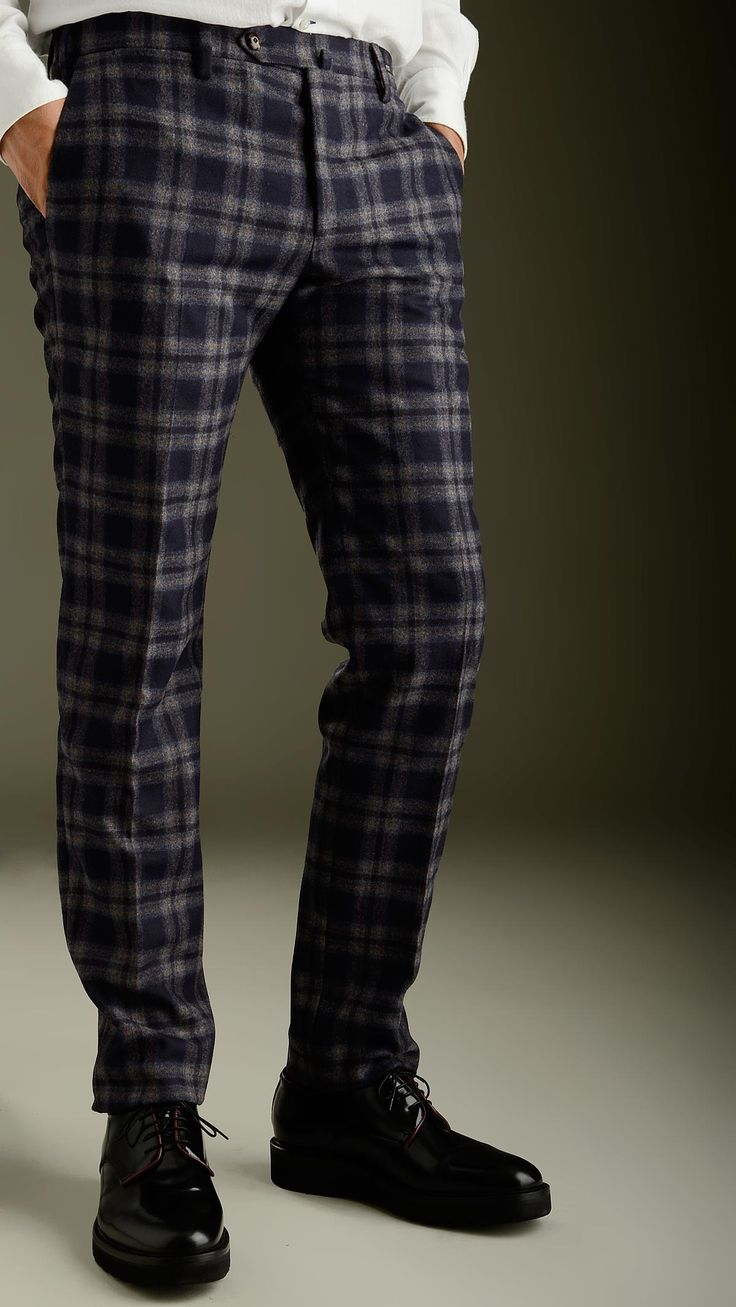 Blue tartan pattern lined trousers in blue featuring concealed button fastening, two slant pockets at front, two welt pockets at back, belt loop, slim fit, 100% wool.