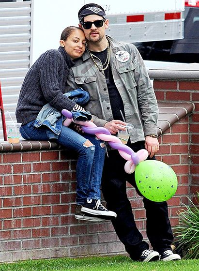Contented Maddens Nicole Richie and hubby Joel Madden took a breather during a family outing at a park in Santa Monica Jan. 27, 2014.