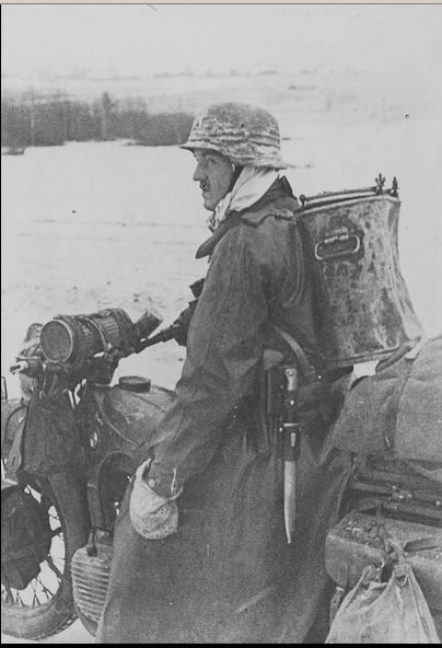 German soldiers on a motorcycle BMW with food thermos on the road during the Battle of Moscow.