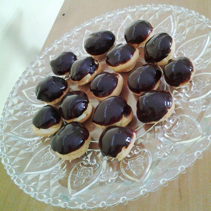 Chocolate Glazed Apricot Cream Puffs.