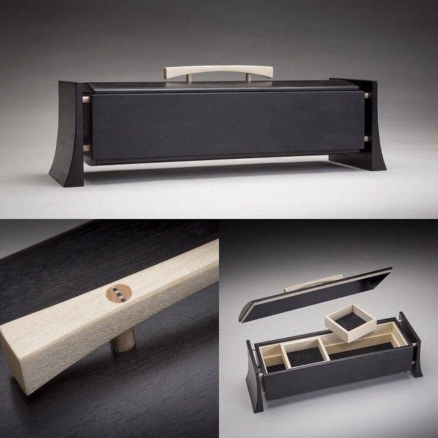 """This is one of my personal favourites, a truly unique box in solid Gabon Ebony and English Sycamore. The hand-shaped handle is attached to the lid with through-pegs wedged with shop-made multi-coloured wedges (1/4"""" pegs to give you an idea of scale). Inside are two sliding and removable trays which, along with the base of the main box, are lined with black lamb skin suede. The rebate on the underside of the lid assembly is lined with Sycamore veneer to create a further striking contrast…"""