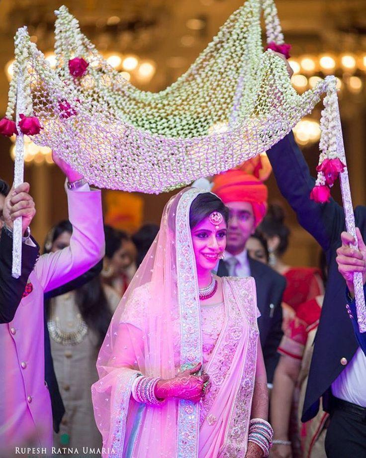 "A more delicate version of the ""Phoolon ki Chaadar"" . Popular on the WedMeGood gallery shot by @framesandfilms |  #wedding #weddings #bride #bridalentry #pink #entrance #flowershower #indianwedding #indianbride #pinkbride #weddingday #weddingdress #dday"