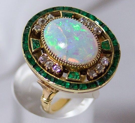 """""""wedding gift, sent Alfonso XII and María de las Mercedes (Queen of Spain) a rich golden ring in which it was enshrined a beautiful opal.""""  Maria died just six months after their marriage, two days before her 18th birthday."""