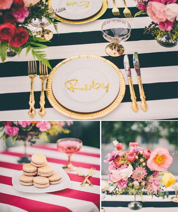 Dinner party celebration decoration: black & white striped table cloth, gold cutlery, pink flowers