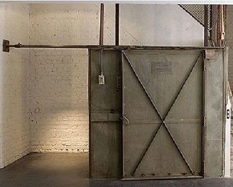 Barn doors that slide in front of shelves or across master for privacy