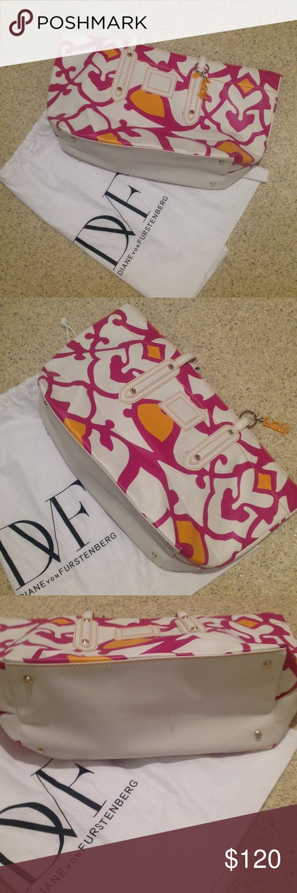 DVF Bag Fun DVF Print bag.  Used for one season. Attached love life keychain. Small mark on bottom shown in third picture. Interior has 3 pockets - one is a zippered pocket. Includes original dust bag. Diane von Furstenberg Bags