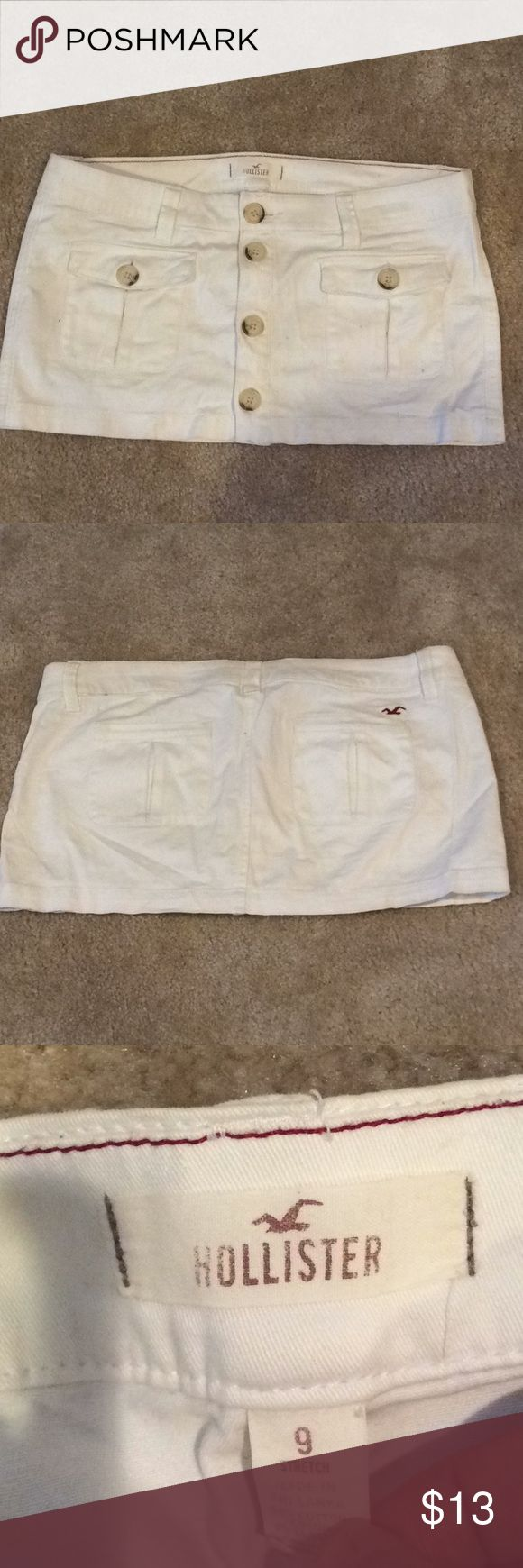 Hollister skirt White stretchy Hollister skirt. Has a cute set of 4 buttons going up it, and 2 on the pockets. Hollister Skirts Mini