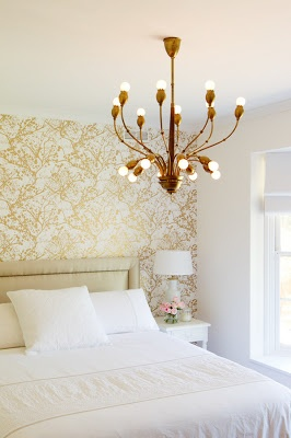 A wallpaper accent wall love the gold wall paper for Gold wallpaper living room