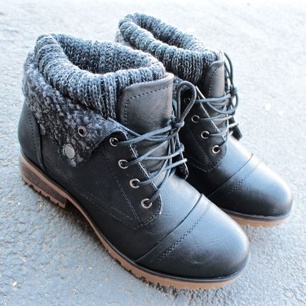 Adorable cozy boots sock detailing adorns these black booties. Featuring a laced up front, side button snaps gives the ability to wear the booties folds up or down, and threaded soles. Comfy and styli