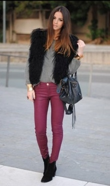 Colored jeans and fur vest.