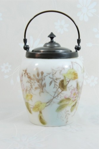 """Floral Decorated Mount Washington Glass Lidded Biscuit Jar "", in excellent condition, no cracks, chips.This wonderful floral adorn milk glass biscuit jar is crowned with what arrears to be a pewter lid, with spiral knob."
