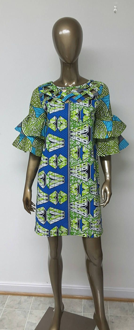 This is a beautifulAfrican Print Shift Mini Dress. Tiered Bell Sleeves. Lattice Work Yoke . Handmade. Womens. Dress length between 32 and 36 inches.    INCLUDED: • One dress DETAILS: • African Print • Care Instructions: Cold wash. Press  DRESS SIZES * US 2 – Bust 33 - Waist 24 inches - Hips 34-35 inches * US 4 -- Bust 34 - Waist 25 inches - Hips 36-37 inches * US 6 -- Bust 35 - Waist 26 inches - Hips 38 inches * US 8 -- Bust 36 - Waist 28 inches - Hips 39 inches * US 10 -- Bust 37 - Waist…