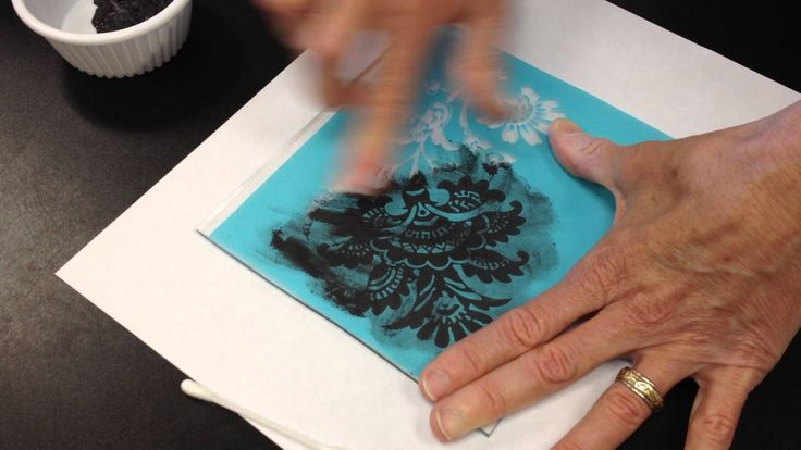Silk screening on glass. Works the same way on ceramic items as well