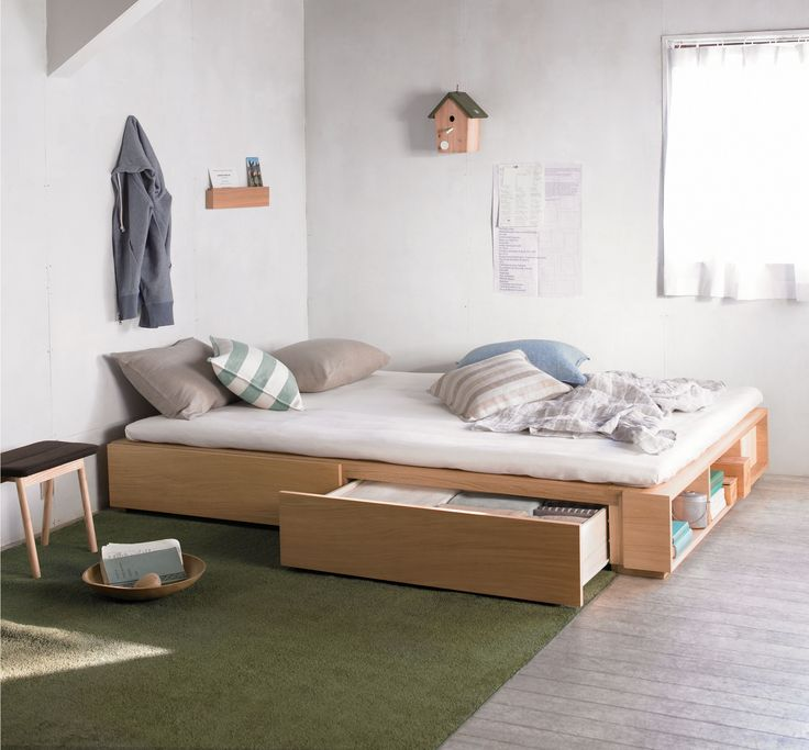 Muji Oak Storage Bed - Double. Drawers on one side, under mattress storage on the other side.