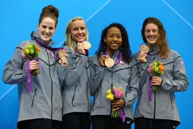 Brooklyn's Lia Neal (second from r.) shows off her bronze medal with 4x100 teammates Missy Franklin (l.), Jessica Hardy and Allison Schmitt (r.) on the podium.  USA