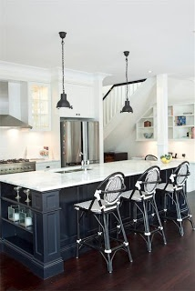 By Mixing Black And White With Stainless Steel Appliances