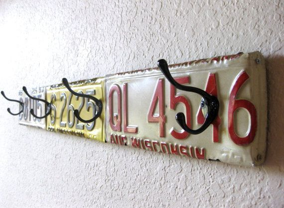License Plate Coat Hook - Hammer to shape and screw some old license plates onto a 2x4. Screw on a few purchased or recycled coat hooks. Hang in your entryway, garage, or man-cave