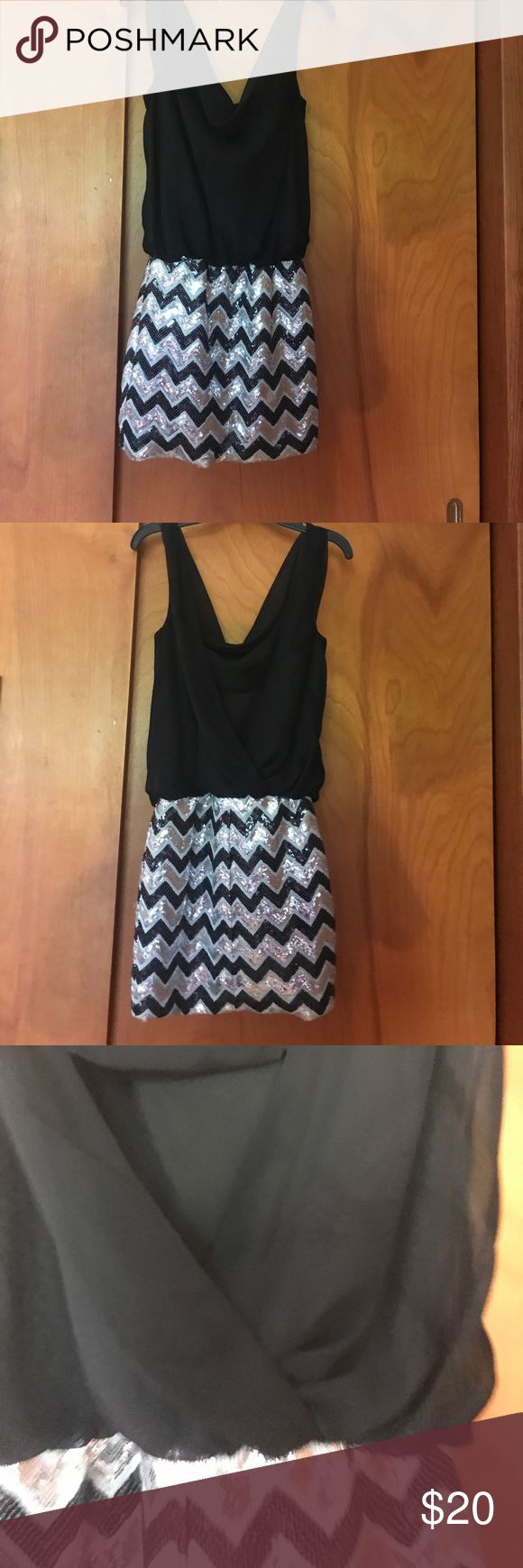 Night Out Dress Top is blousy and has a small cut out in the back, the skirt part is sequenced with silver and black chevron. The dress fits tight on the bottom half and blousy on the top, perfect for a night out (: Dresses Mini