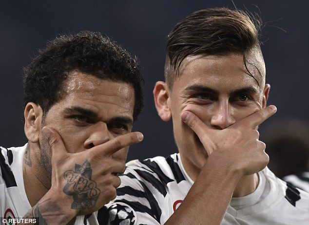 Dybala and Dani Alves don their masks to celebrate the Argentine's penalty goal in Turin