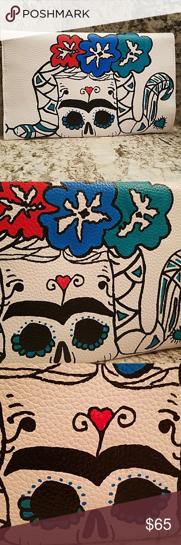 "Frida Kahlo Day of the Dead  Sugar Skull Clutch Frida Kahlo Sugar Skull clutch is a handpainted piece of wearable art. It is vegan leather  in white with goldtone hardware clasp.   The envelope closure reads ""Me entenderas"" which translates to ""you will understand me"" and the inside of the flap has a hidden message which reads, ""Cuando te duele el alma como a mi.""  That translates to "" when your soul hurts like mine."" This is a Frida Kahlo quote. Her initials are painted below the quote to…"