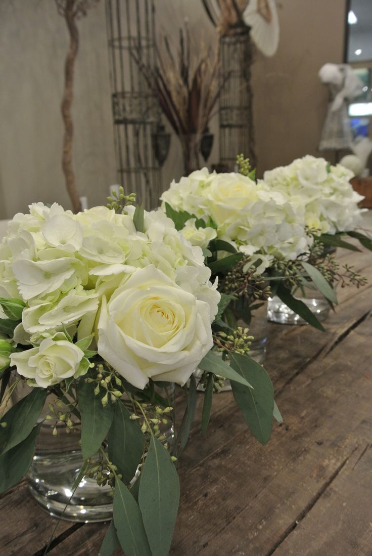 Small centerpieces with hydrangea rose spray roses
