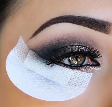 """Get a box of 30 from Amazon for $8.Promising review: """"These are awesome and very simple to use. I use this these on my clients all the time! They have become my best friend when creating a perfect winged eyeliner. Ladies are who getting into beauty really would benefit from this a lot. I don't have to worry about being perfect with my eye shadow. Tip: Cut the shadow shields in half to increase longevity. If you're doing a more drastic look, use a whole shadow shield."""" —Awesome Blossom"""