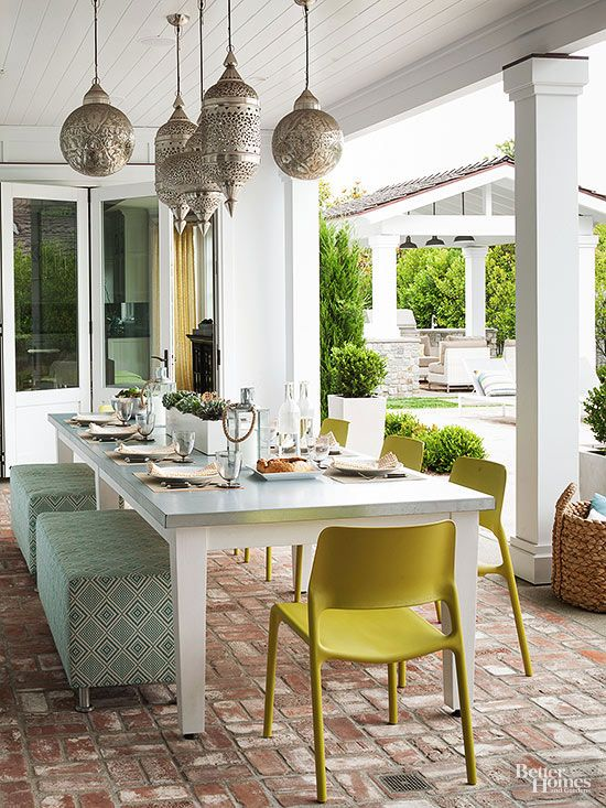 Add interest overhead and extend your outdoor space's usable hours by hanging sconces over the dining table.