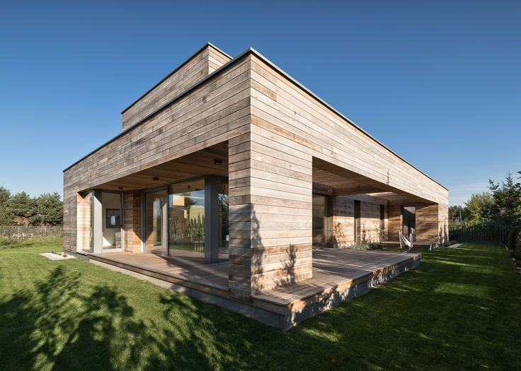 Superb Architects Office Mariusz Wrzeszcz Has Created A Single Storey House In  Poland Featuring Cedar Clad Walls, And A Glazed Living Room Opening Out To  A Terrace Great Pictures
