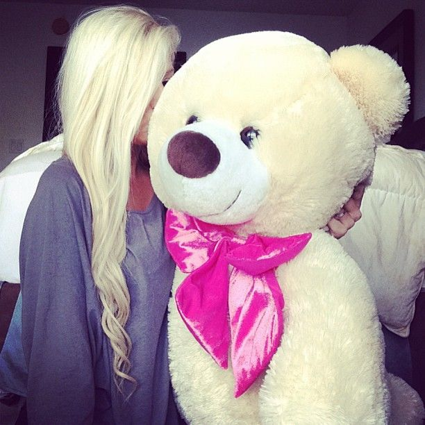 i am in love with the long blonde hair, with curls at the end! the teddy bear is so cute also! lol