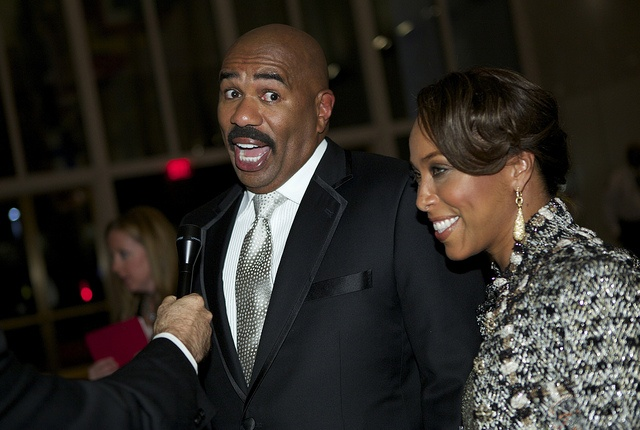 Steve Harvey (pictured w/ wife Marjorie Bridges Harvey) was friendly with the cameras during red carpet interviews. (Credit: Scott Suchman)