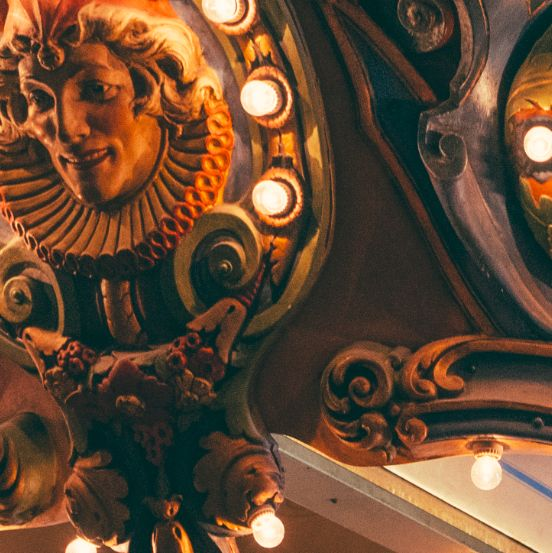 A guardian of merriment in The Carousel Bar & Lounge.