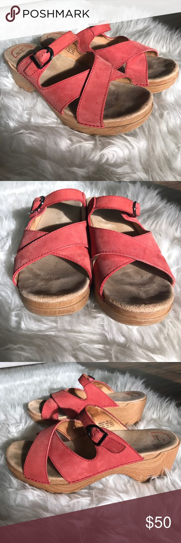 Dansko sandal clogs Comfortable and cute Dansko. Slide on sandal clog, no back. Leather upper, size 40. Some pull on left elastic at buckle as pictured. Some knicks on bottom left side. Dansko Shoes