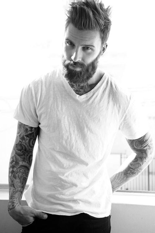 Mmm. There's just something about a guy in a white t-shirt and tattoos showing. I'd like one now, please...
