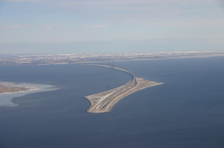 The Oresundbridge (official name: Øresundsförbindelsen) connecting Copenhagen in Denmark and Malmö in Sweden leaves one puzzled, as suddenly a 4-line highway and a 2-track railway seem to disappear into the sea.  In any case, it's definitely the longest combined road-and-rail bridge in Europe.   It opened in July 2000. The bridge is 8 km long, plus there's 4 km of tunnel and another 4 km of the man-made island Peberholm; altogether a stunning, 16-km-drive.
