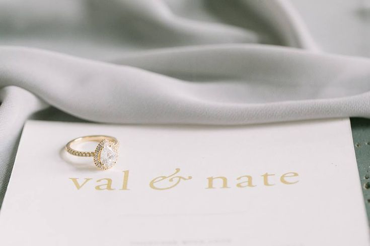 Ecksand Pear Cut Diamond Halo Engagement Ring featured in The Wedding Co's French-inspired style shoot.