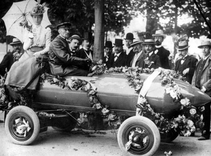 Racing Heroes: Camille Jenatzy, with his wife, driving La Jamais Contente in a victory parade