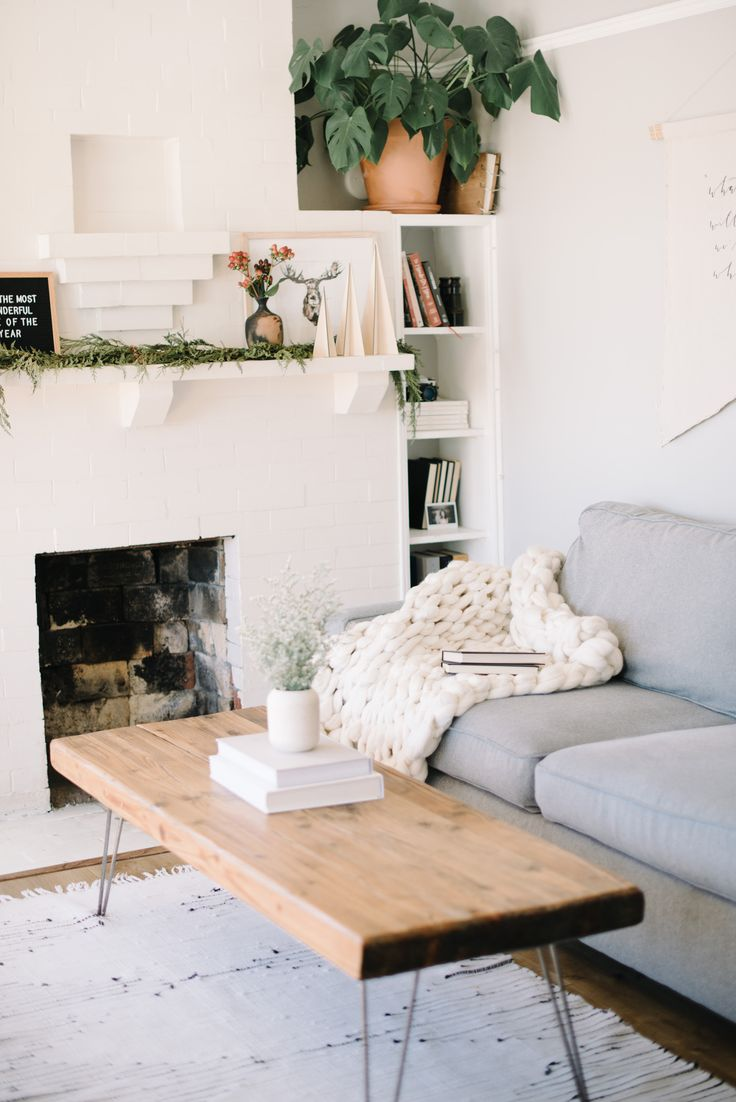 Living space complete with a cozy chunky knit blanket from crafters box
