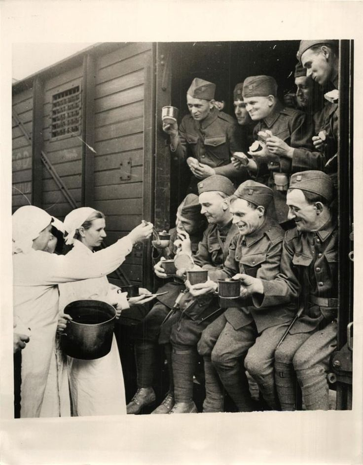 1938- Czech soldiers receiving refreshments as they prepare to leave Prague by train.
