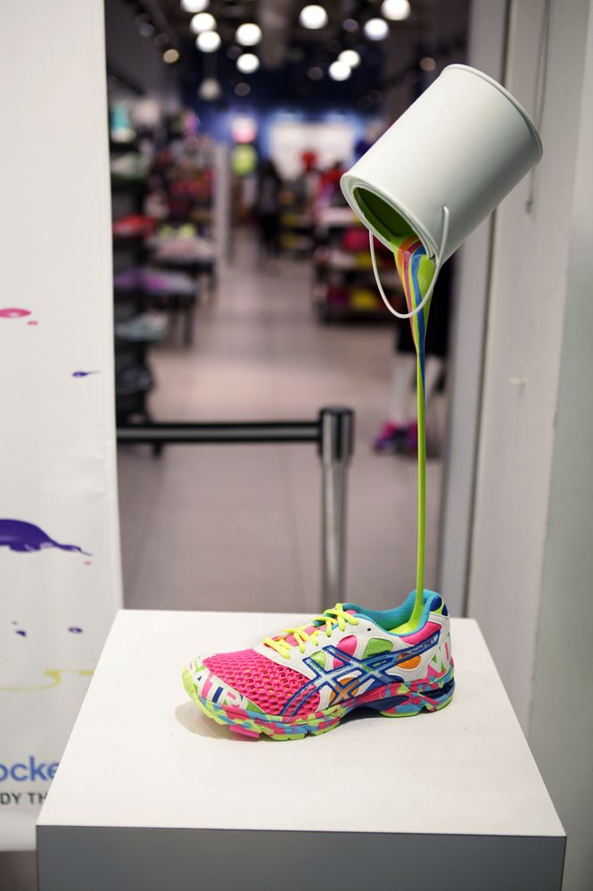 We love this POUR IT ON sneaker display for Asics and Foot Locker. #retail #merchandising #shoe #display #paint #colour