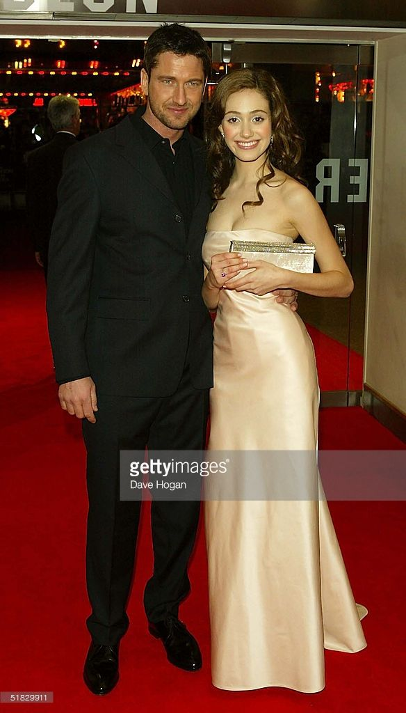 Actors Emmy Rossum and Gerard Butler arrive at the World Premiere of 'Phantom Of The Opera' at the Odeon Leicester Square on December 6, 2004 in London.